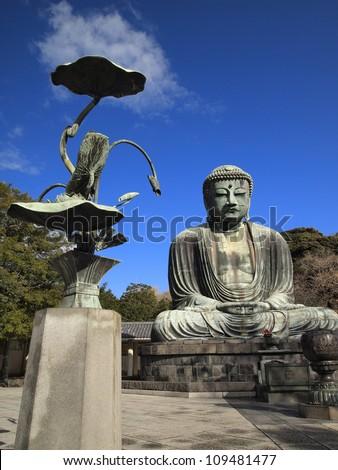 KAMAKURA, JAPAN - DEC 11: The Great Buddha of Kamakura on Dec 11, 2010 in Kamakura, Japan. This is a monumental outdoor bronze statue of Amida Buddha probably dates from 1252 - stock photo