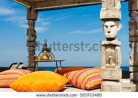 Kamasutra kind of Canopy for sunbathing on a beach - stock photo