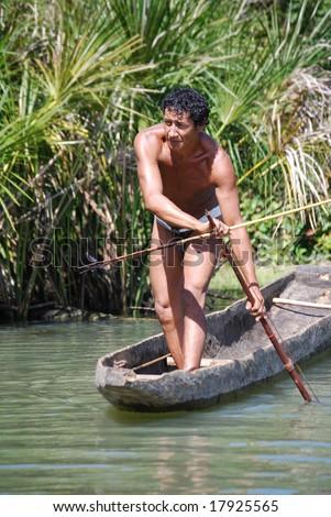"KAMAYURA VILLAGE, BRAZIL - MAY 18: Ataulo ""Cotia"" Kamayura is the most skilled fisherman of the Kamayura tribe, catching fish on May 18, 2008, near the lakeside village."
