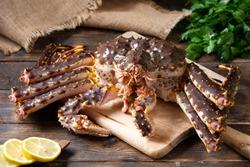 Kamchatka crab. King raw crab on the kitchen table. Kamchatka crab is on the table. Cooking process
