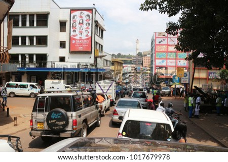 Kampala, Uganda - June 6, 2016: Heavy traffic in the center of Kampala. Kampala is the capital city of Uganda in Africa. Busy life in downtown Kampala. The town is chaotic and overpopulated.