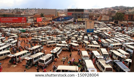 KAMPALA, UGANDA - SEPTEMBER 28, 2012.  The busy and chaotic taxi park on a normal week day in Kampala, Uganda on September 28,2012.