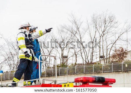 Kanagawa, Japan - January 5: The fire fighters on the rescue car perform fire fighting show in the New Year\'s Fire Review at Nissan Stadium on January 5, 2013 in Kanagawa, Japan.