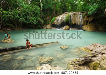 KANCHANABURI, THAILAND - JUNE 24: People traveling and bath in Erawan waterfall, Thailand on June 24, 2017 - Shutterstock ID 687120685