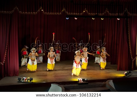 KANDY, SRI LANKA - MARCH 30: Sri Lankan dancers in traditional costumes perform for tourists in Kandyan Cultural Centre on March 30, 2012 in Kandy, Sri Lanka