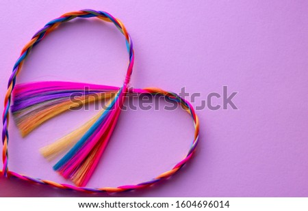 Kanekalon. Colored artificial strands of hair. Material for plaiting braids