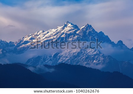 Kangchenjunga close up view from Pelling in Sikkim, India. Kangchenjunga is the third highest mountain in the world. #1040262676