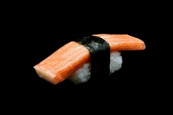 Kani sushi or Crab stick top on rice rap by Seaweed. Japanese tradition food with black isolated background