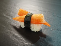 Kanikama Crab sticks nigiri sushi on black stone slate background  japanese food style