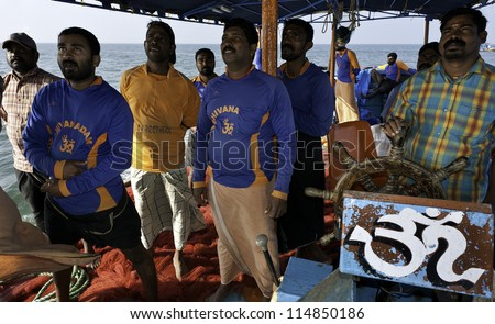 KANNUR - DECEMBER 22: unidentified fishermen on board fishing vessel watch the radar for signs of fish on December 22, 2011 along the Malabar coast off Mapilla Bay Harbour at Kannur, Kerala, India.