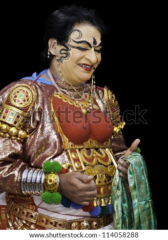 KANNUR - DECEMBER 06: Unidentified Kathakali performer with full make-up and elaborate costume prior to a performance on December 06, 2011 at a small village near Kannur, Kerala, India.