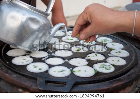 Kanom Krok Phueng, a traditional Thai dessert made from crushed coconut meat. Zdjęcia stock ©