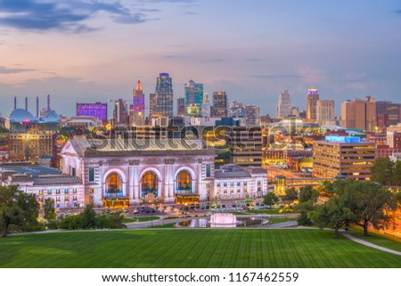 Kansas City, Missouri, USA downtown skyline with Union Station at dusk.