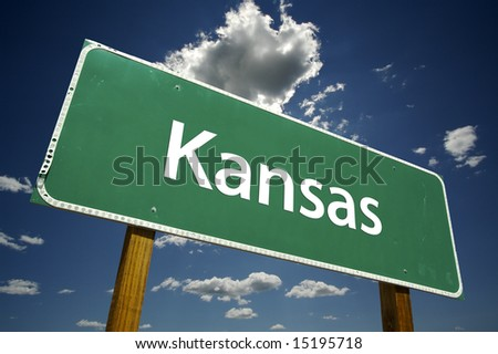 Kansas Road Sign with dramatic clouds and sky.