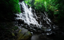 Kanto Lampo Waterfall gianyar bali - Scenic, seasonal waterfall cascading down a stepped rock wall into a shallow wading pool during sunrise