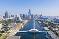 Kaohsiung, Taiwan-2021: Aerial photography of Kaohsiung City and Kaohsiung Harbor:Landscape view of Kaohsiung Pedestrian Swing Bridge (Dagang Bridge) in sunny weather.