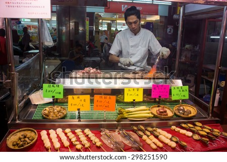 Kaohsiung, Taiwan - April 20,2015 : Chef cooking food to be sold in Liuhe Night Market in Kaohsiung, Taiwan