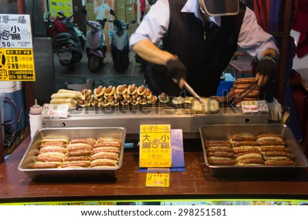 Kaohsiung, Taiwan - April 20,2015 : Chief cooking food to be sold in Liuhe Night Market in Kaohsiung, Taiwan