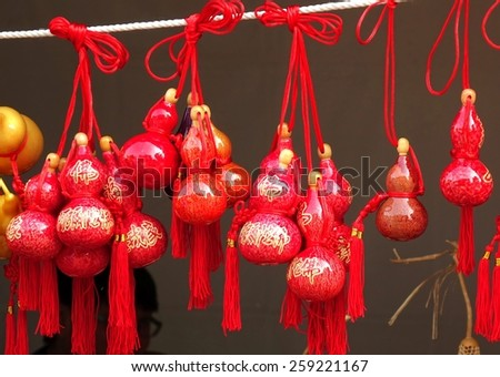 KAOHSIUNG, TAIWAN -- FEBRUARY 19, 2015: An outdoor vendor sells small dried gourds that are painted and decorated with Buddhist scriptures.