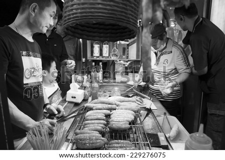 Kaohsiung, Taiwan - NOVEMBER 9, 2014: Street food market in Kaohsiung night market.  People enjoy food at night market in taiwan.  And is one of the unique culture in Taiwan.  November 9, 2014