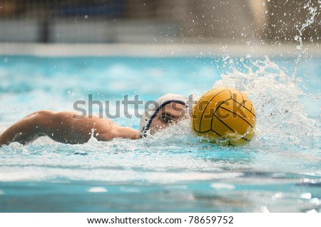 KAPOSVAR, HUNGARY - APRIL 16: Unidentified player in action at a Hungarian national championship water-polo game between Kaposvari VK and Hegyvidek Ybl WPC on April 16, 2011 in Kaposvar, Hungary