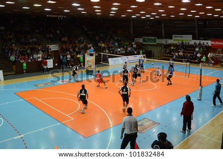 KAPOSVAR, HUNGARY - APRIL 21: Unidentified players in action at a Hungarian National Championship volleyball game Kaposvar (blue) vs. Kecskemet (black), April 21, 2012 in Kaposvar, Hungary. - stock photo