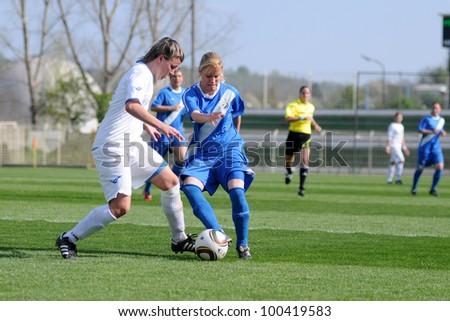 KAPOSVAR, HUNGARY - APRIL 20: Unidentified  players in action at Hungarian Cup Final women soccer game  MTK (blue) vs. Viktoria FC (white) April 20, 2011 in Kaposvar, Hungary.