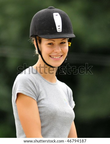 KAPOSVAR, HUNGARY - AUGUST 5: Leila Gyenesei (world champion in modern pentathlon) with her horse on a training , August 5, 2008 in Kaposvar, Hungary
