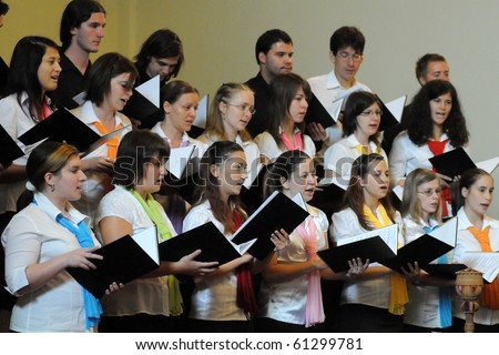 KAPOSVAR, HUNGARY - AUGUST 26: Members of the Liszt Ferenc Music School Choir sing at the IV. Pannonia Cantat Youth Choir Festival August 26, 2010 in Kaposvar, Hungary - stock photo
