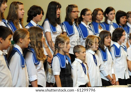KAPOSVAR, HUNGARY - AUGUST 26: Members of the Marianum Komarno Choir sing at the IV. Pannonia Cantat Youth Choir Festival August 26, 2010 in Kaposvar, Hungary