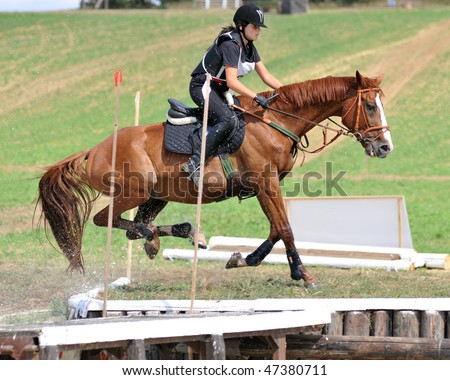 KAPOSVAR, HUNGARY - AUGUST 30: Unidentified competitor with her horse on a Hungarian Cross-Country Championship, August 30, 2008 in Kaposvar, Hungary.