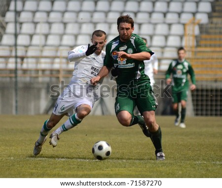 KAPOSVAR, HUNGARY - FEBRUARY 16: David Hegedus (L) in action at a Hungarian National Cup soccer game Kaposvar vs Paks February 16, 2011 in Kaposvar, Hungary.