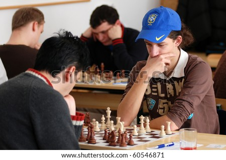 KAPOSVAR, HUNGARY - FEBRUARY 18: Unidentified chess player concentrates at the Hungarian National Championship I/B. chess competition between Kaposvar and Decs February 18, 2007 in Kaposvar, Hungary.