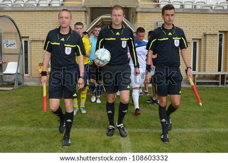 KAPOSVAR, HUNGARY - JULY 21: Anto Maric referee (C) in action the VIII. Youth Football Festival U17 Final SYFA W.R.  (yellow)(SCO) vs. Brescia Academy (white) (ITA) July 21, 2012 in Kaposvar, Hungary