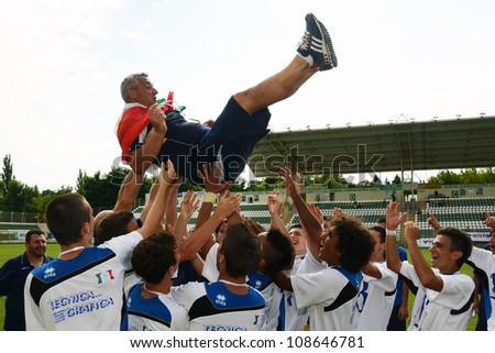 KAPOSVAR, HUNGARY - JULY 21: Brescia players celebrate at the VIII. Youth Football Festival U17 Final SYFA W.R.  (yellow)(SCO) vs. Brescia Academy (white) (ITA) July 21, 2012 in Kaposvar, Hungary