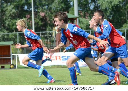 KAPOSVAR, HUNGARY - JULY 20: Minsk players celebrate at the IX. Youth Football Festival match Minsk (red) (BLR) vs. Brasov (yellow) (ROM) on July 20, 2013 in Kaposvar, Hungary