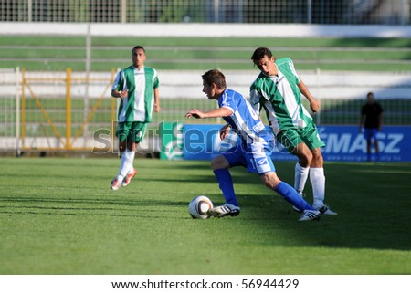 KAPOSVAR, HUNGARY - JULY 10: Unidentified players in action at a friendly soccer game Kaposvar (HUN) vs. Varazdin (CRO) - July 10, 2010 in Kaposvar, Hungary.