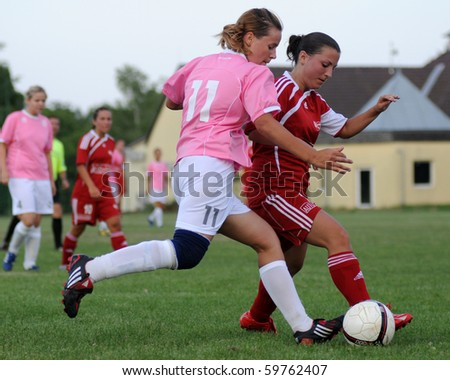 KAPOSVAR, HUNGARY - JULY 20: Unidentified players in action at a VI. Youth Football Festival match Olympia Bruntal (CZE) vs. Nagybajom (HUN)- July 20, 2010 in Kaposvar, Hungary