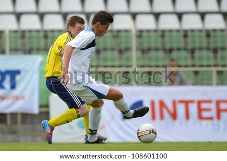 KAPOSVAR, HUNGARY - JULY 21: Unidentified players in action at the VIII. Youth Football Festival U17 Final SYFA W.R.  (yellow)(SCO) vs. Brescia Academy (white) (ITA) July 21, 2012 in Kaposvar, Hungary