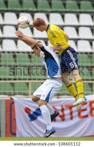KAPOSVAR, HUNGARY - JULY 21: Unidentified players in action at the VIII. Youth Football Festival U17 Final SYFA W.R.  (yellow)(SCO) vs. Brescia Academy (white) (ITA) July 21, 2012 in Kaposvar, Hungary