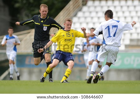 KAPOSVAR, HUNGARY - JULY 21: Unidentified players in action at the VIII. Youth Football Festival U17 Final SYFA W.R. (yellow) (SCO) vs. Brescia Academy (white) (ITA) July 21, 2012 in Kaposvar, Hungary