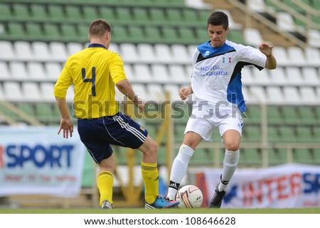 KAPOSVAR, HUNGARY - JULY 21: Unidentified players in action at the VIII. Youth Football Festival U17 Final SYFA W.R. (yellow) (SCO) vs. Brescia Academy (white) (ITA) July 21, 2012 in Kaposvar, Hungary