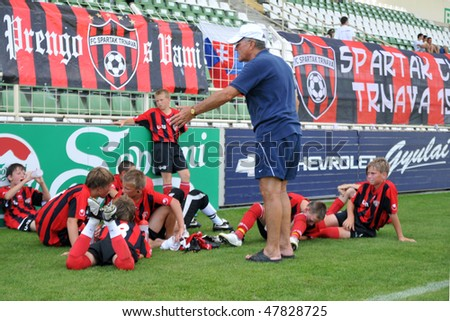 KAPOSVAR, HUNGARY - JULY 22: Unidentified players listen to their trainer at the V. Youth Football Festival match FC Furth (AUT) vs. Spartak Trnava (SVK) - July 22, 2009 in Kaposvar, Hungary