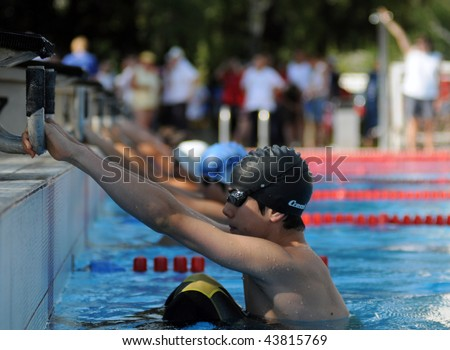KAPOSVAR, HUNGARY - JUNE 18: Unidentified competitors start off at the Hungarian Country Championship on June 18, 2008 in Kaposvar, Hungary. - stock photo
