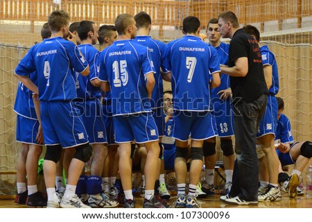 KAPOSVAR, HUNGARY - MAY 18: Dunaferr players listening to trainer at the final of the hungarian junior volleyball championship (Kaposvar  white vs. Dunaferr  blue), May 18, 2012 in Kaposvar, Hungary