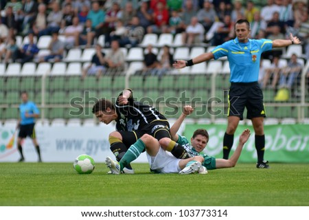 KAPOSVAR, HUNGARY - MAY 12: Kornel Kulcsar (in black) in action at a Hungarian National Championship soccer game Kaposvar (green) vs Szombathely (black) May 12, 2012 in Kaposvar, Hungary.