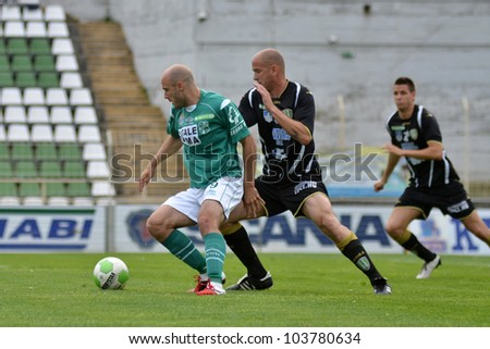 KAPOSVAR, HUNGARY - MAY 12: Miroslav Grumic (in green) in action at a Hungarian National Championship soccer game Kaposvar (green) vs Szombathely (black) May 12, 2012 in Kaposvar, Hungary.
