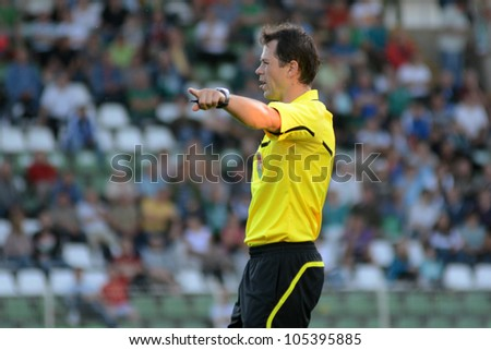 KAPOSVAR, HUNGARY - MAY 27: Roland Veizer (referee) in action at a Hungarian National Championship soccer game Kaposvar (white) vs Zalaegerszeg (black) May 27, 2012 in Kaposvar, Hungary.