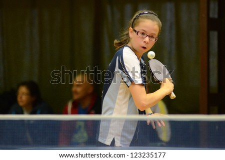 KAPOSVAR, HUNGARY - NOVEMBER 18: Laura Magyarcsik in action at a Hungarian National Championship II. table tennis game Kaposvar (blue) vs. Noszlop (white) November 18, 2012 in Kaposvar, Hungary.