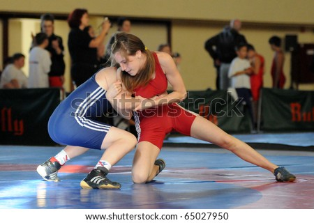 KAPOSVAR, HUNGARY - NOVEMBER 6: Unidentified competitors wrestle int he Intersport Cup Greco Roman Wrestling Competition, November 6, 2010 in Kaposvar, Hungary. - stock photo